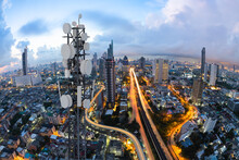 Telecommunication Tower With 5G Cellular Network Antenna On Nice City Background