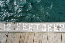 "Edge Of Dock Says """"12 Feet Deep"""""