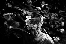 Cheeky Young Man With Flowers Covering His Face
