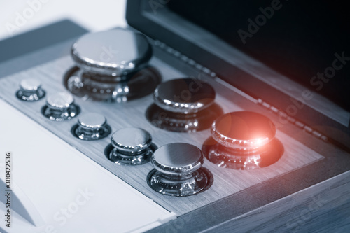 Fototapeta Set of standard weight in box for calibration process quality control lab closeu