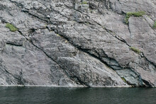 Rock Cliff Background Beside Lake