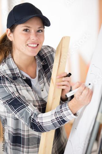 Fototapeta cheerful professional carpenter woman smiling at the camera obraz