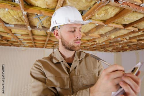 Fototapeta construction man working on clipboard obraz