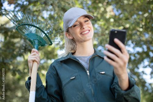 Fototapeta happy young woman or gardener with garden tools obraz