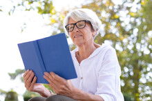 Senior Woman Reads A Book