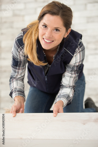 Fototapeta concentrated female wood worker with woo d obraz