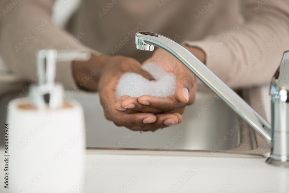 Fototapeta woman washing hands in sink