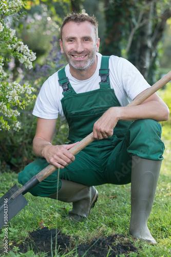 Fototapeta portrait of a handsome senior man gardening in his garden obraz