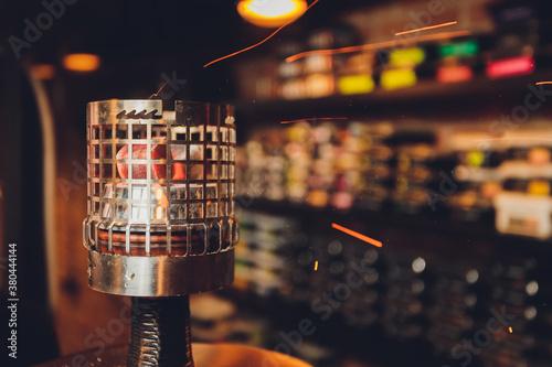Fotografie, Obraz Coals for hookah close-up. Burning coals on the hookah bowl.