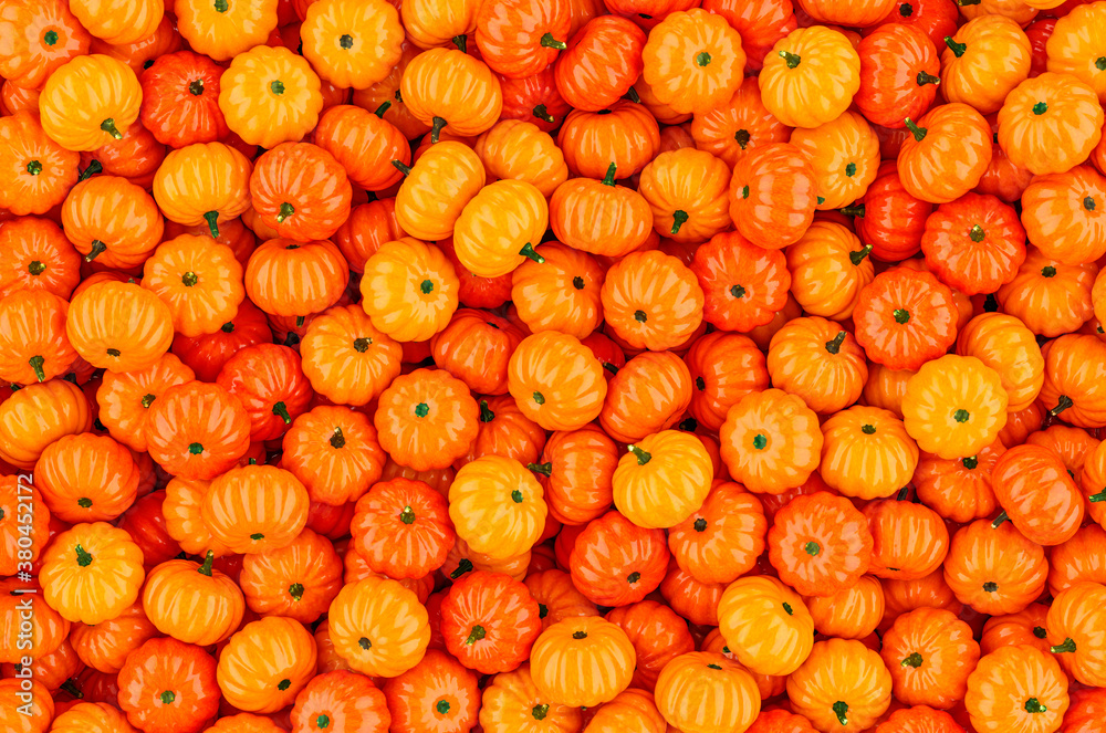 Fototapeta Background from orange pumpkins, 3D rendering