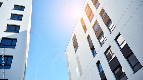 Architectural details of modern apartment building. Modern european residential apartment building complex with sunlight.