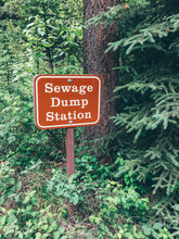 Sewage Dump Station Sign In The Middle Of The Woods
