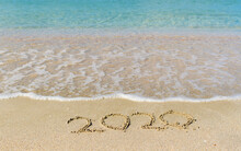 Sea Wave Next To The Inscription 2020 On The Beach. The Inscription Of The Ending 2020 In The Sand.