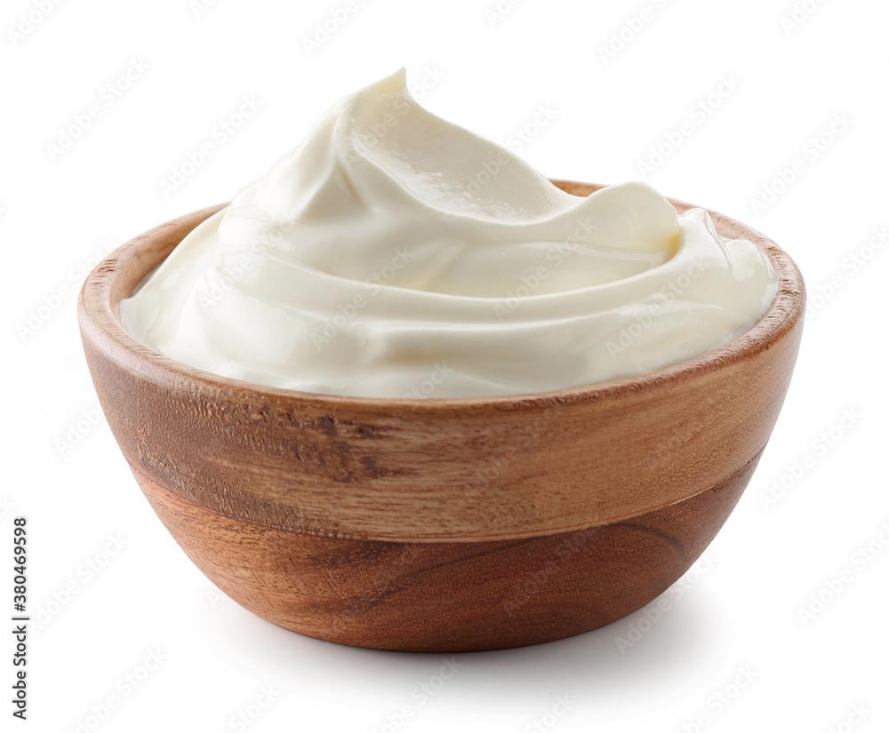 Fototapeta wooden bowl of whipped sour cream yogurt
