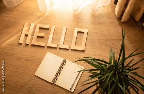 Greeting lettering hello on a beautiful background with attributes notepad pen f Wallpaper Mural