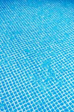 Rain Falling On Water Surface In The Pool