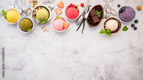 Various of ice cream  flavours in bowl blueberry ,green tea ,coconut ,strawberry and chocolate  setup on white stone background Wallpaper Mural