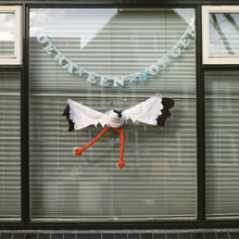 Funny Toy Stork Against A Window, Celebrating The Birth Of A Baby