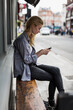 Woman using mobile phone outdoor in the city