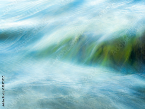 Vászonkép Closeup, long exposure of water flowing over rocks
