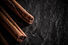 Cinnamon Sticks On Black Stone...
