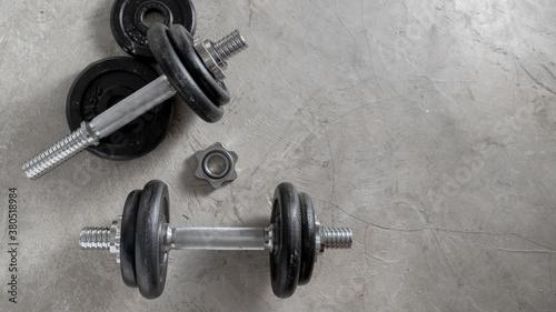 Fotografie, Obraz Steel dumbbells on the cement floor in the gym For bodybuilders