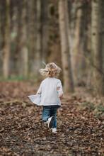 Cute Blond Little Girl Running Through Autumnal Forest