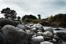Large Rounded Boulders At Stony River (Hangatahua River) In Taranaki Region Of New Zealand