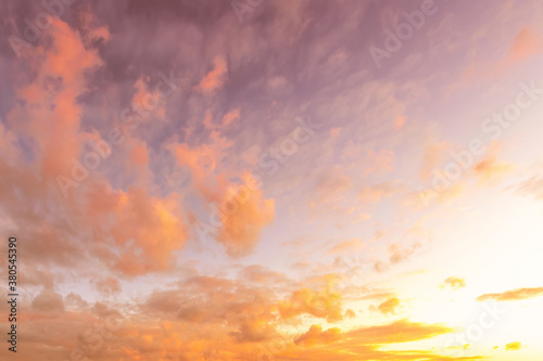 Colorful orange-purple dramatic clouds lit by the setting sun against the evening sky Wallpaper Mural
