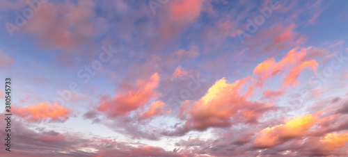 Fotografija Colorful orange-purple dramatic clouds lit by the setting sun against the evening sky