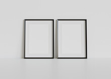 Two Black Frames Leaning On Wh...