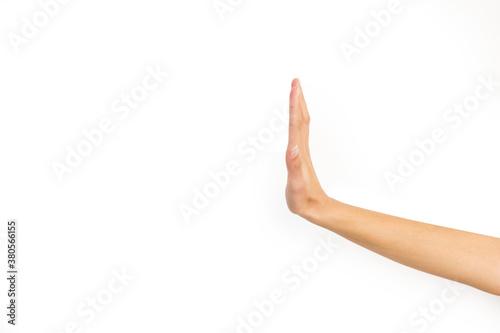 Mano mujer mostrando un signo de gesto de mano stop sobre un fondo blanco liso y aislado Canvas Print