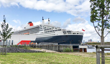 Famous Cunard Oceanliner, Cruiseship Or Cruise Ship Liner QM2 Queen Mary 2 At Steinwerder Terminal In Port Of Hamburg, Germany On Sunny Day Before Transatlantic Crossing To New York