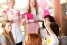 Pink: Woman Holds Up Winning Raffle Ticket