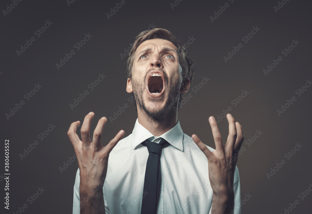 Fototapeta Angry stressed man shouting out loud