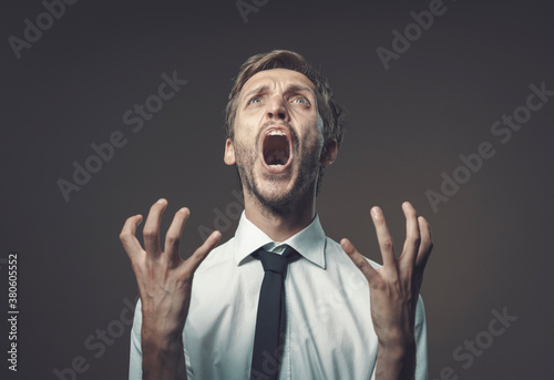 Angry stressed man shouting out loud Fototapeta