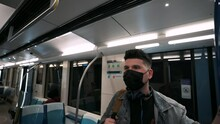 Man Wearing Face Mask While Standing Inside The Moving Train At The Underground Metro In Montreal, Quebec, Canada.  - Closeup Shot