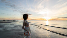 Woman And Sunrise Shot Over Th...