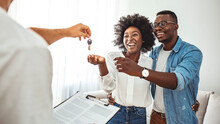 Couple Getting Keys From Realt...