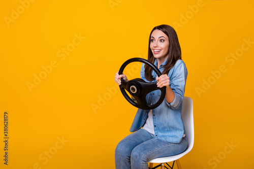 Fotografiet Profile photo of pretty funny lady good mood sit chair hold steering wheel ride