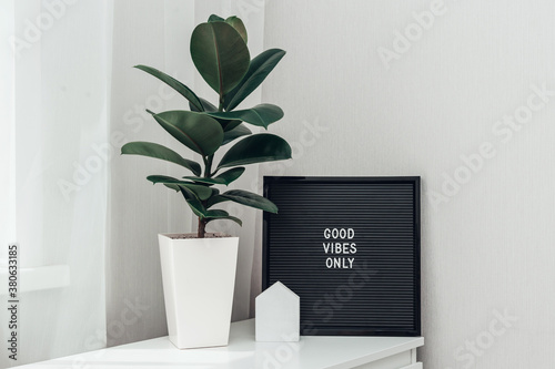 Fototapeta Inspirational quote good vibes only on black letterboard in light interior obraz