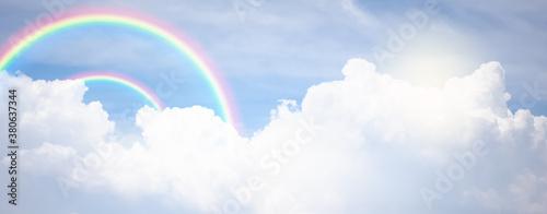 Fototapeta rainbow in cloudy sky