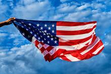 Man Waving An American Flag On...