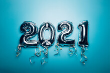 Balloon Bunting For Celebration Of New Year 2021 Made From Silver Number Balloons. Holiday Party Decoration Or Postcard Concept, On Blue Background