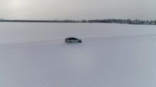 Car On A Snowy Winterroad. Shot By Drone