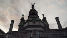 Looking Up At Notre-Dame-de-Bon-Secours Church Statue On A Cloudy Day From Rue De La Commune Road In Montreal, Quebec, Canada. Coronavirus Pandemic. - Low Angle -  Parallax