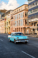 Classic Car Passing At Top Speed In El Malecon, Cuba