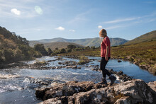 Women Walking, Exploring The River And Mountain