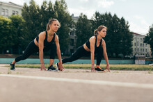 Two Friends Preparing The Body, Before Starting To Run In The Running Club, In Belarus, Minsk.