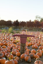 Asian Kid Posing As Scarecrow